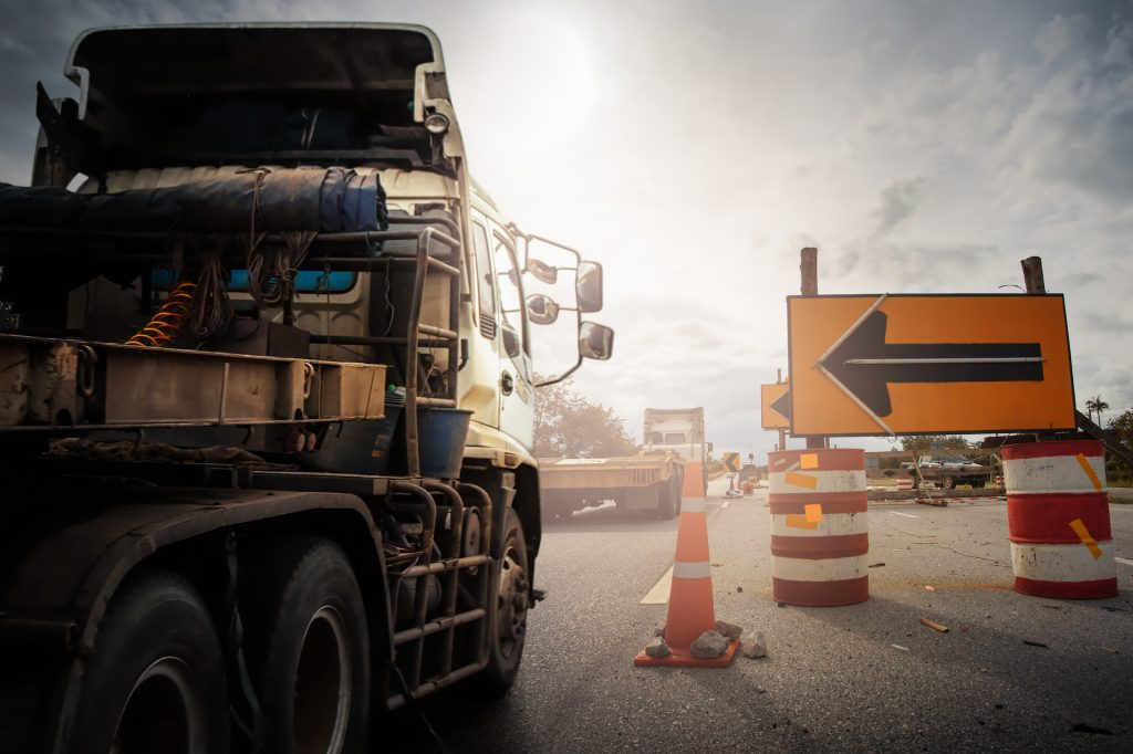 """Truck with Traffic cones and """" Diversion"""" sign outside a construction zone."""